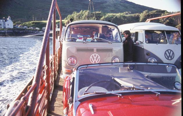 Vintage camper-vans crossing on a ferry